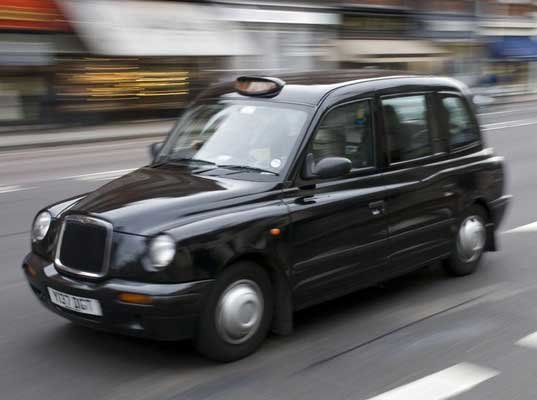 Carbodies taxi photo - 1